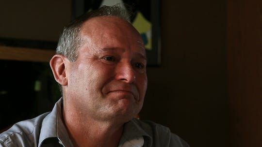 Jeff Dettbarn tries to hold back tears during an interview on Thursday afternoon, Aug. 30, 2018, at his home in eastern Iowa. Dettbarn is a CT technologist at the Iowa City Veterans Affairs Medical Center.