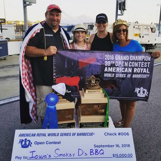 The Warth family poses with their winnings from the American Royal World Series of Barbecue.