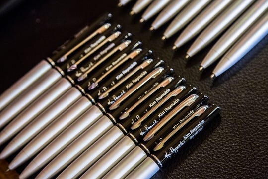 Rows of pens are set out for Kim Reynolds, Governor of Iowa, to use as she signs her first bill as governor, SF 512 which deals with water quality, on Wednesday, Jan. 31, 2018, at the Iowa State Capitol.