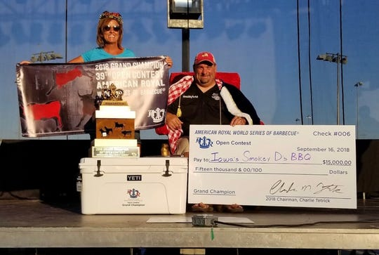 Darren and Sherry Warth pose with their winnings from the American Royal World Series of Barbecue.