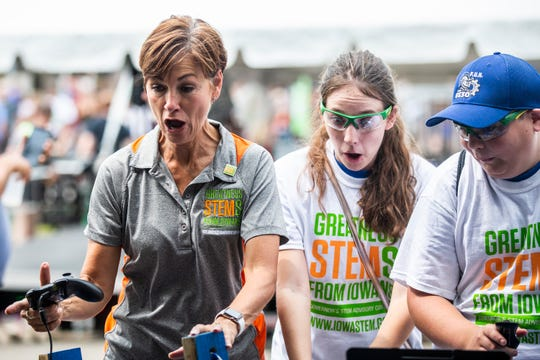 Iowa Governor Kim Reynolds reacts after crashing a robot into a wall while sampling the activities set up for STEM Day at the Iowa State Fair, Sunday, Aug. 19, 2018, in Des Moines. STEM education in Iowa has been a priority of Governor Reynolds.