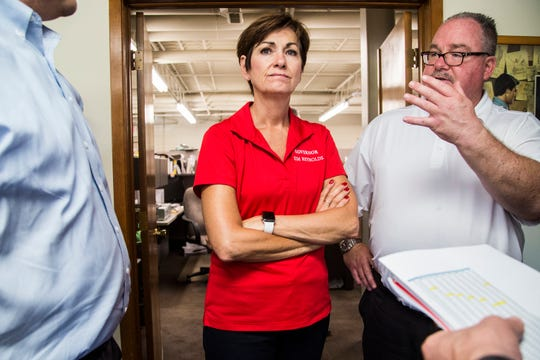 Iowa Governor Kim Reynolds, accompanied by the Mayor of Clive, Scott Cirksena, visit Business Letter, a commercial printer in Clive, while touring flood damaged areas of Polk County on Monday, July 2, 2018. Walnut Creek flooded businesses and homes in Clive on Saturday night.