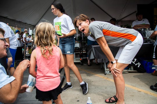 Iowa Governor Kim Reynolds encourages Violet Hagan, 6 of Iowa City, to try a STEM Day at the Iowa State Fair activity on Sunday, Aug. 19, 2018, in Des Moines. Implementing STEM education in Iowa has been a priority for Reynolds.