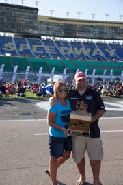 Darren and Sherry Warth pose with their trophy at the Kansas City Speedway.