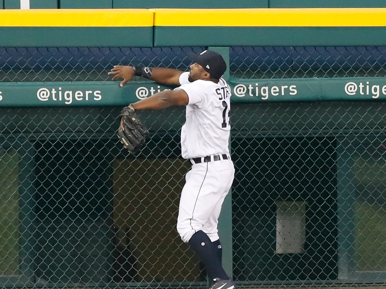 Detroit Tigers' Christin Stewart watches as a fan catches a three-run home run by Kansas City Royals' Jorge Bonifacio during the first inning Thursday, Sept. 20, 2018, in Detroit.