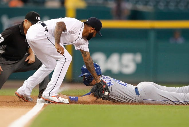 Kansas City Royals' Whit Merrifield beats the tag of Detroit Tigers third baseman Ronny Rodriguez and steals third during the first inning Thursday, Sept. 20, 2018, in Detroit.