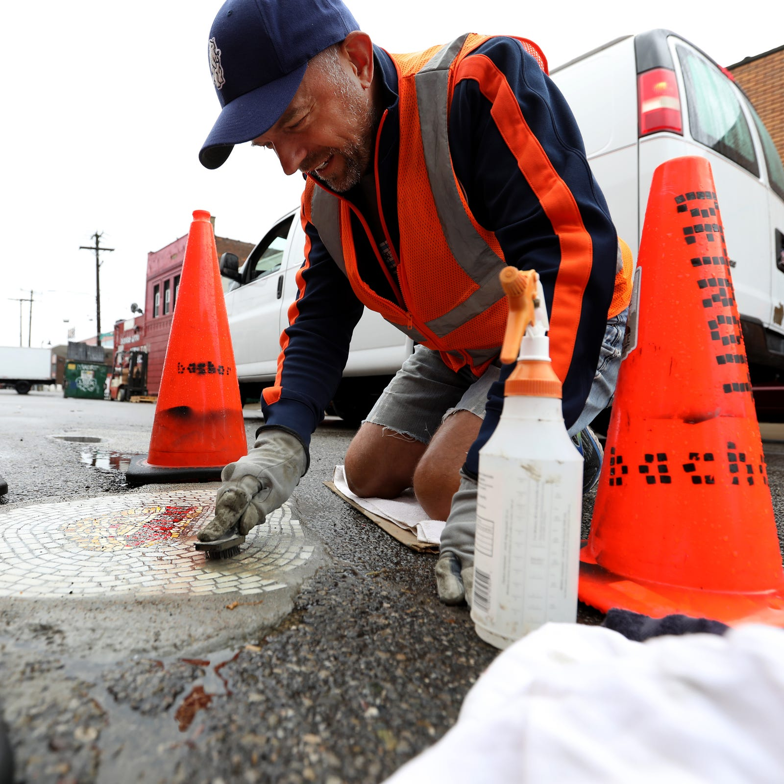 An artist is filling Detroit potholes with mosaics