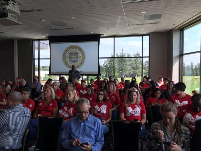 Dozens of University of Michigan nurses attended the board of regents meeting on Thursday, Sept. 20, 2018 to discuss their concerns about a pending union contract.