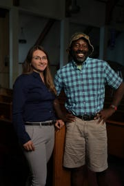 Attorney Tania Morris Diaz poses for a photo with Francis Anwana, 48 who is deaf and has cognitive disabilities, at   Body of Christ International in Detroit on Monday, September 17, 2018. Anwana lives in adult foster care in Detroit.