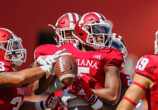Indiana's J'Shun Harris II (5) has returned three punts for touchdowns since last season.