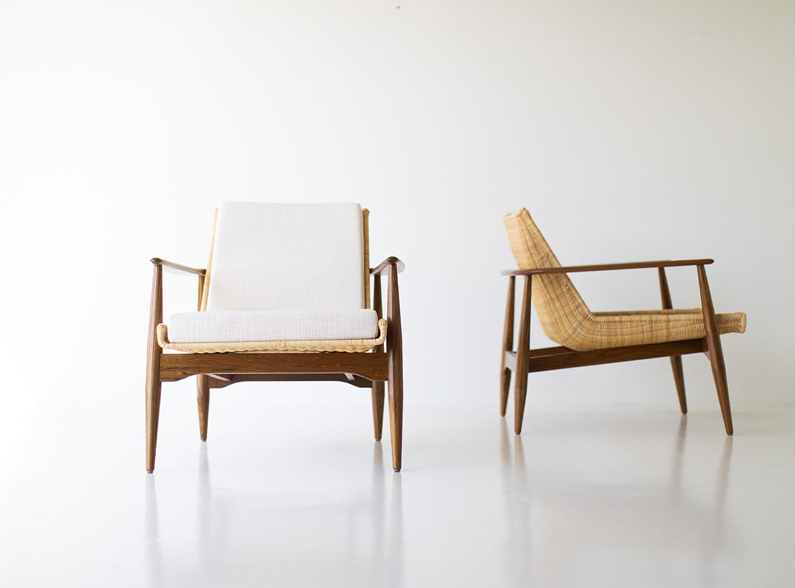 When this Lawrence Peabody chair was introduced in 1962, the rattan sling was imported from Hong Kong. Craft Associates Furniture just reintroduced the design -- but this time, each piece is custom-crafted by artisans in America. Available in solid teak or wicker, the cushion is high-density foam, and the fabric is the customer's choice.