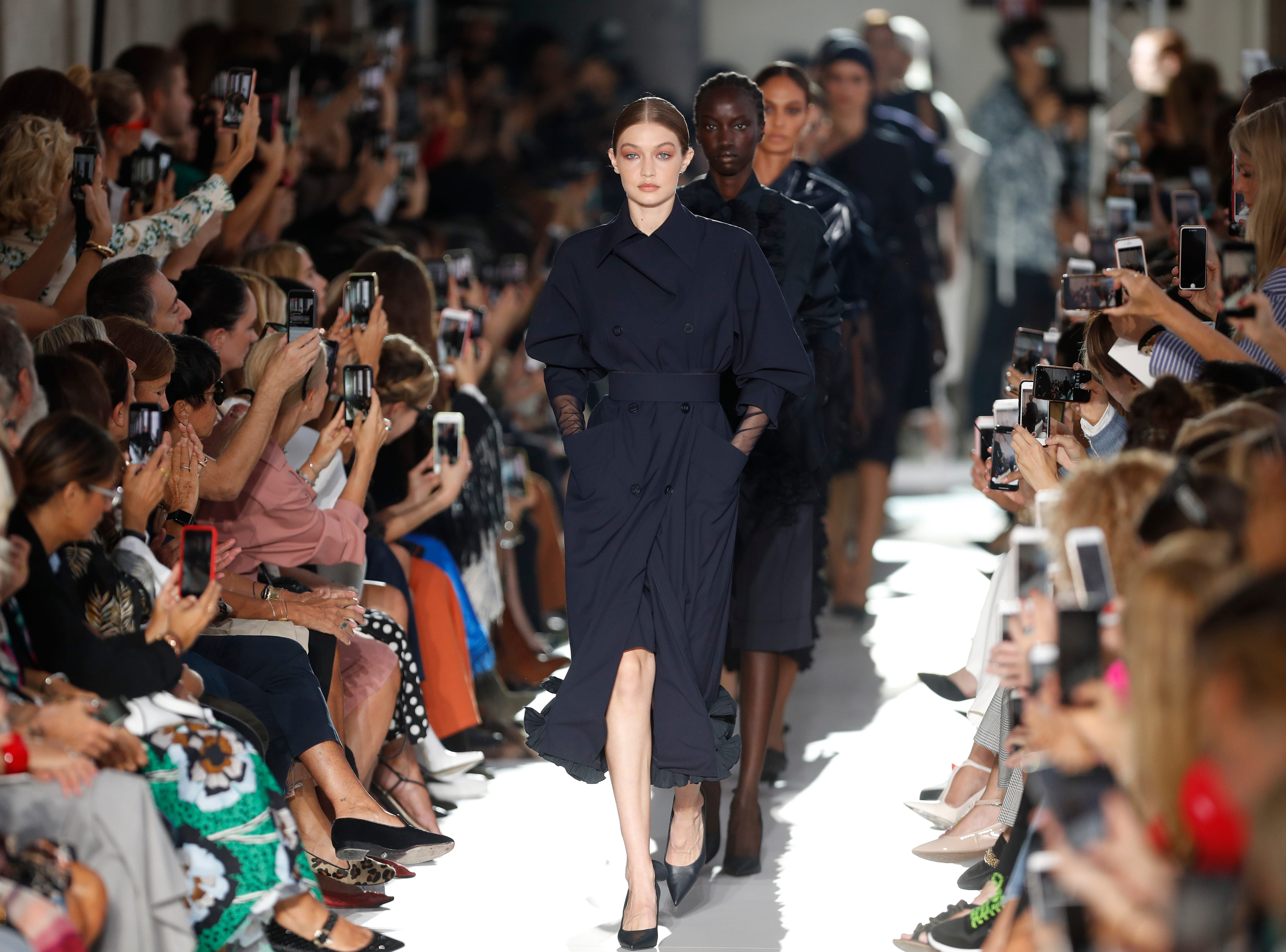 Model Gigi Hadid, front, and other models wear creations as part of the Max Mara women's 2019 spring-summer collection, unveiled during Fashion Week in Milan, Italy, Thursday, Sept. 20, 2018.