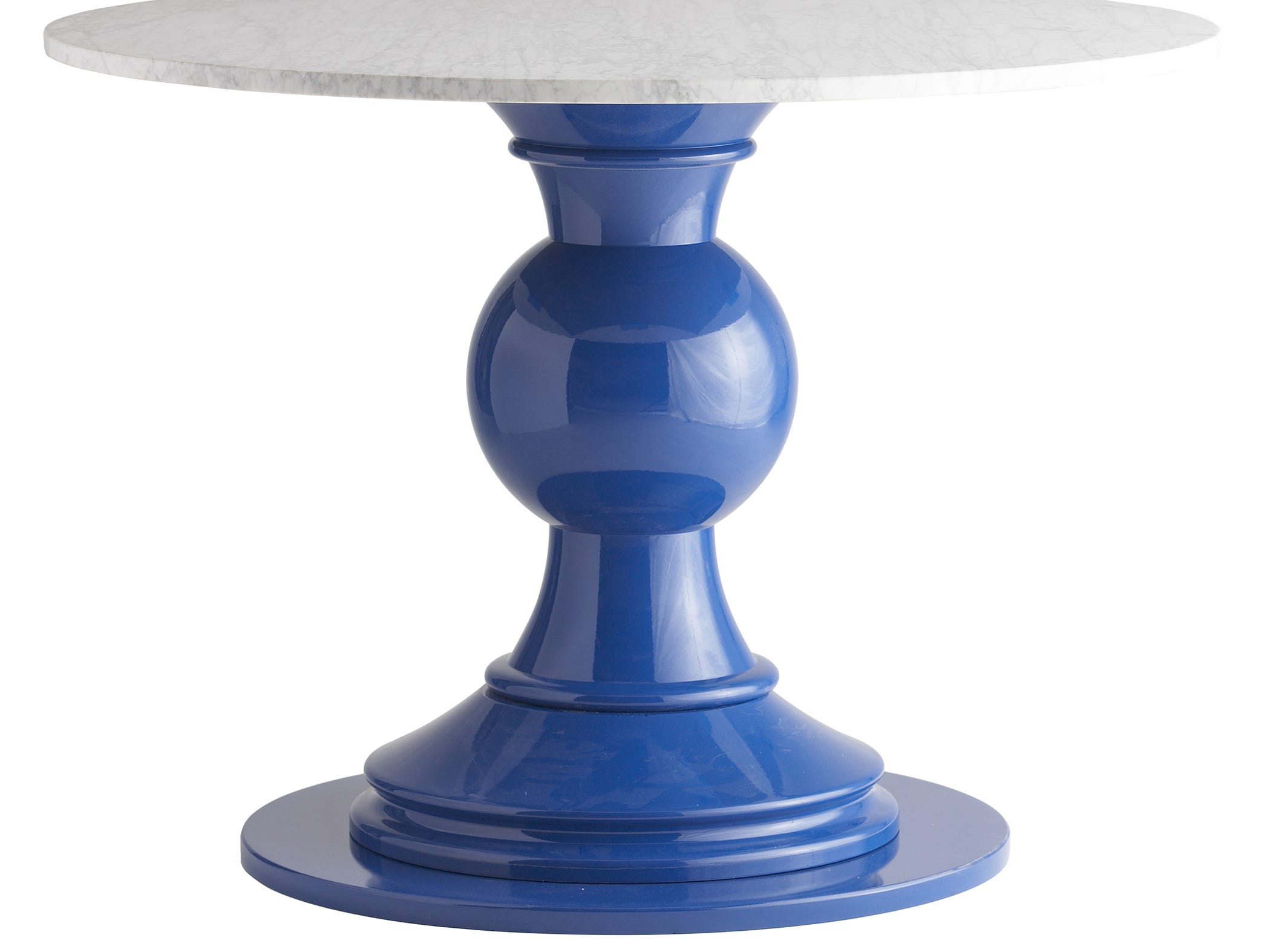 Stacy Kunstel wanted to design a statement table, so she played with proportions alongside partner Michael Partenio until she came up with this massive turned maple base, painted in a glossy custom Benjamin Moore color, Blueberry Hill. She topped the Chunky Captain Compass Table with a 48-inch white-honed Carrara marble.