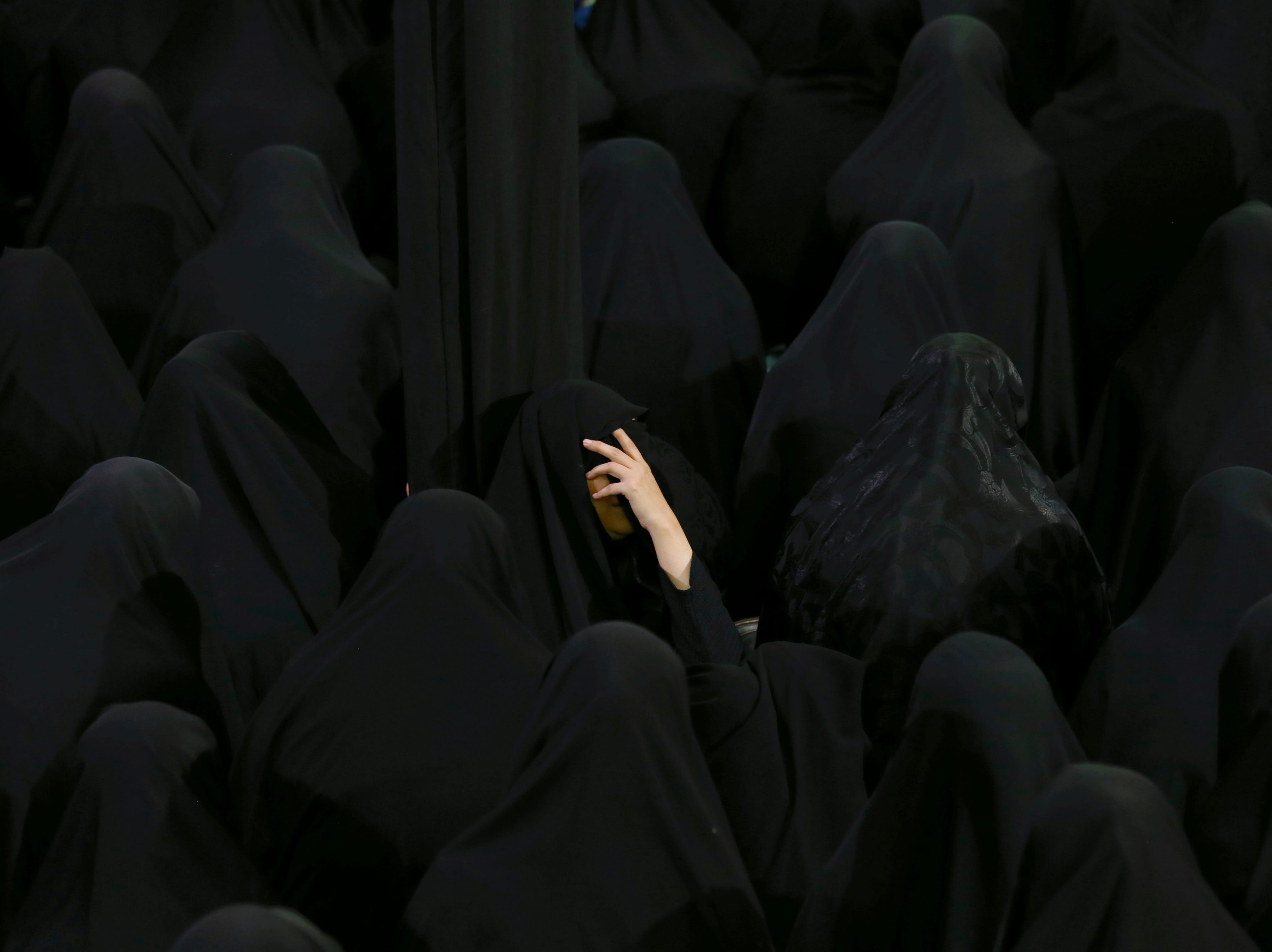 Muslim Shiite women mourn during the holy day of Ashoura at the Sadat Akhavi Mosque in Tehran, Iran, Thursday, Sept 20, 2018. Ashoura is the annual Shiite commemoration of the death of Imam Hussein, the grandson of the Prophet Muhammad, at the Battle of Karbala in present-day Iraq in the 7th century.
