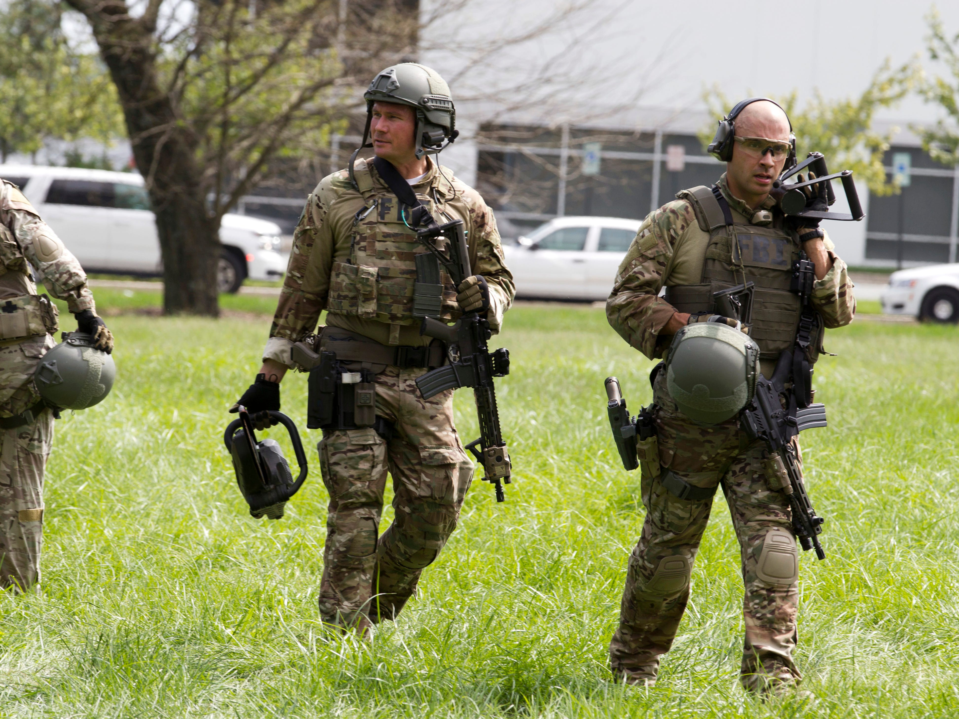 FBI agents are seen at the industrial business park where several people had been shot, according to police reports in Harford County, Md., on Thursday, Sept. 20, 2018.