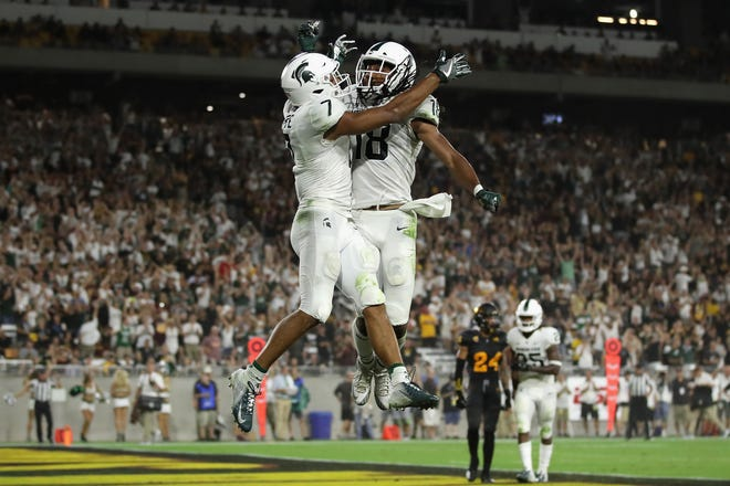 Cody White leads Michigan State with 14 receptions.