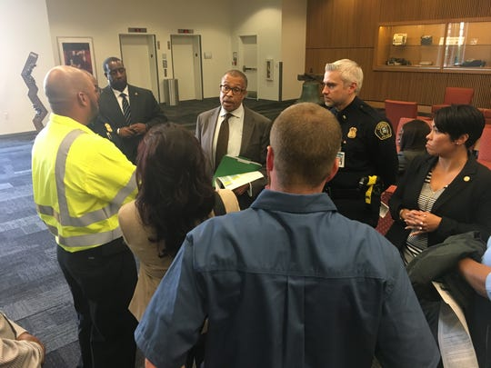 Detroit Police Chief James Craig and Lt. Michael Parish address a group of towers in the hall outside a meeting of the Police Board of Commissioners on Thursday, Sept. 20, 2018.