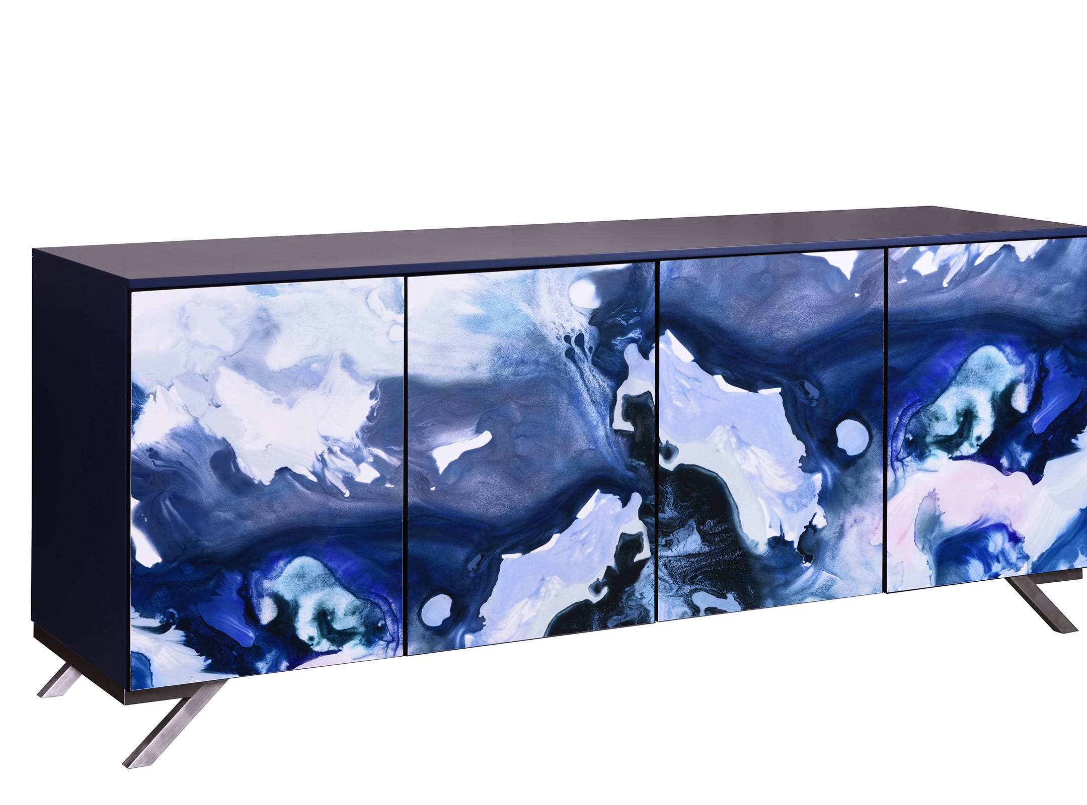 The Lake Shore Watercolor Console from John Strauss Furniture is a piece of art -- a watercolor by Tracy Hiner from Black Crow Studio splashes across the doors. The art was digitally printed, then applied like a veneer to the door panels. Then Strauss put on an acrylic coating in a low sheen for protection. The 84-inch-long, 20-inch-wide, 36-inch-tall case is lacquered with a durable paint in a satin sheen navy; Stainless steel legs in the shape of the numeral 7 are part of a frame that wraps around the back. Touch latch doors open to adjustable shelves.