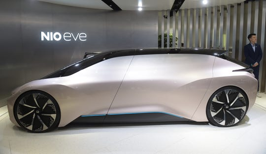 The Nio Eve concept car is displayed during the Beijing Auto Show in Beijing on April 25, 2018. - Industry behemoths like Volkswagen, Daimler, Toyota, Nissan, Ford and others will display more than 1,000 models and dozens of concept cars at the Beijing auto show. (Photo by Nicolas ASFOURI / AFP)        (Photo credit should read NICOLAS ASFOURI/AFP/Getty Images)