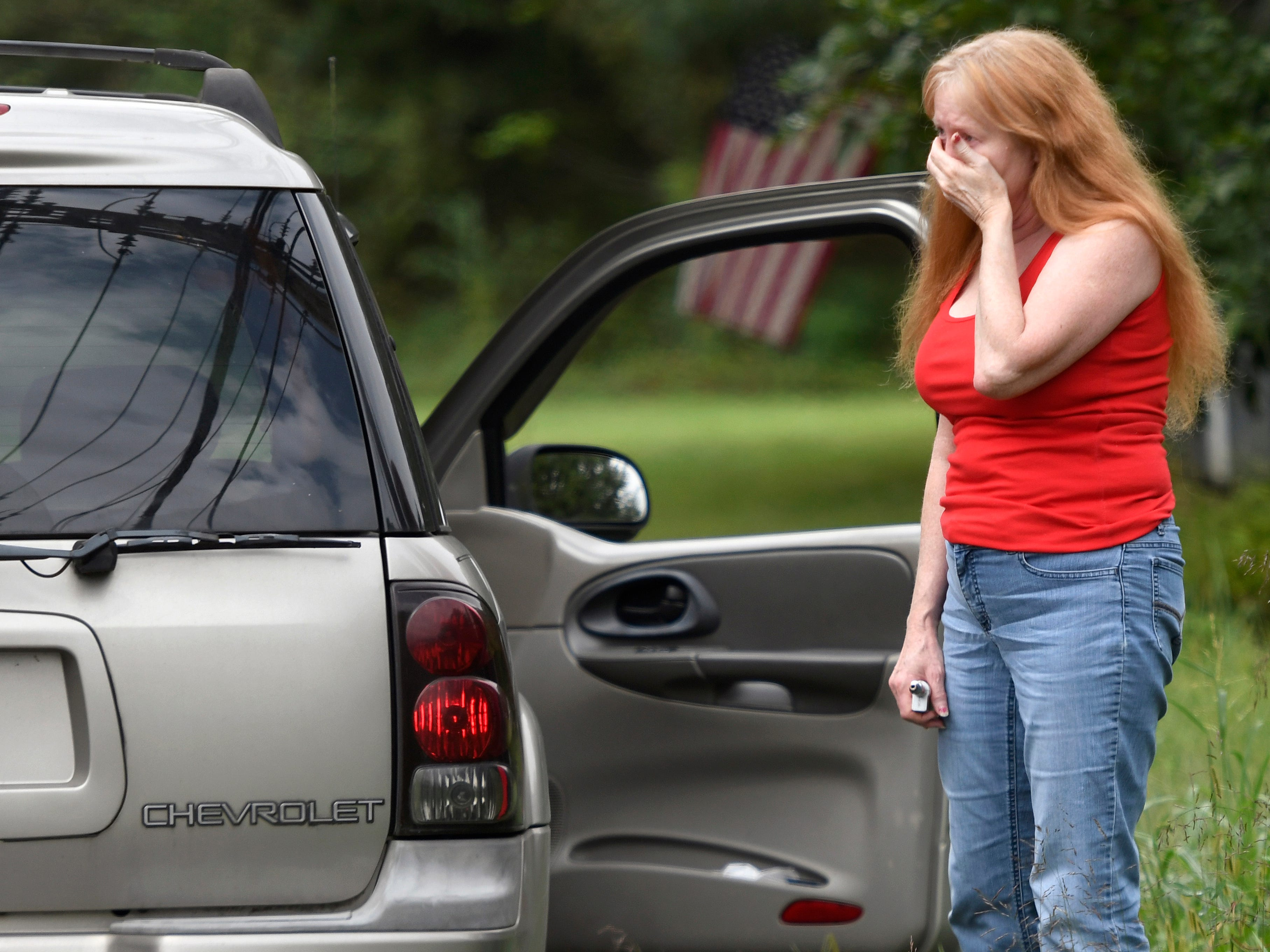 Shirley Pollack of Perryville, Md., reacts to what authorities called a shooting with multiple victims on Thursday, Sept. 20, 2018.
