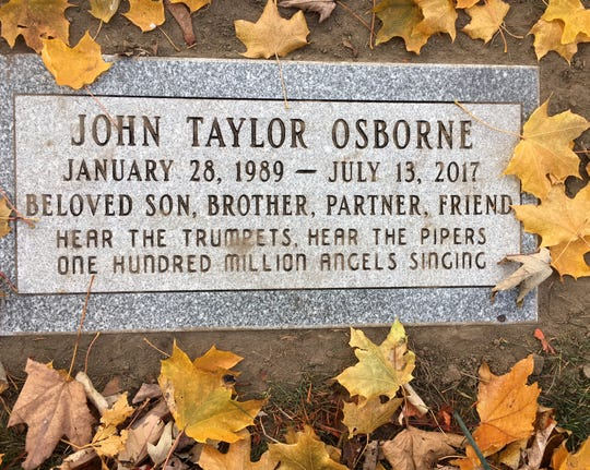 "John Taylor Osborne's grave marker at a small cemetery in Birmingham is inscribed with a lyric from Johnny Cash's ""The Man Comes Around."""
