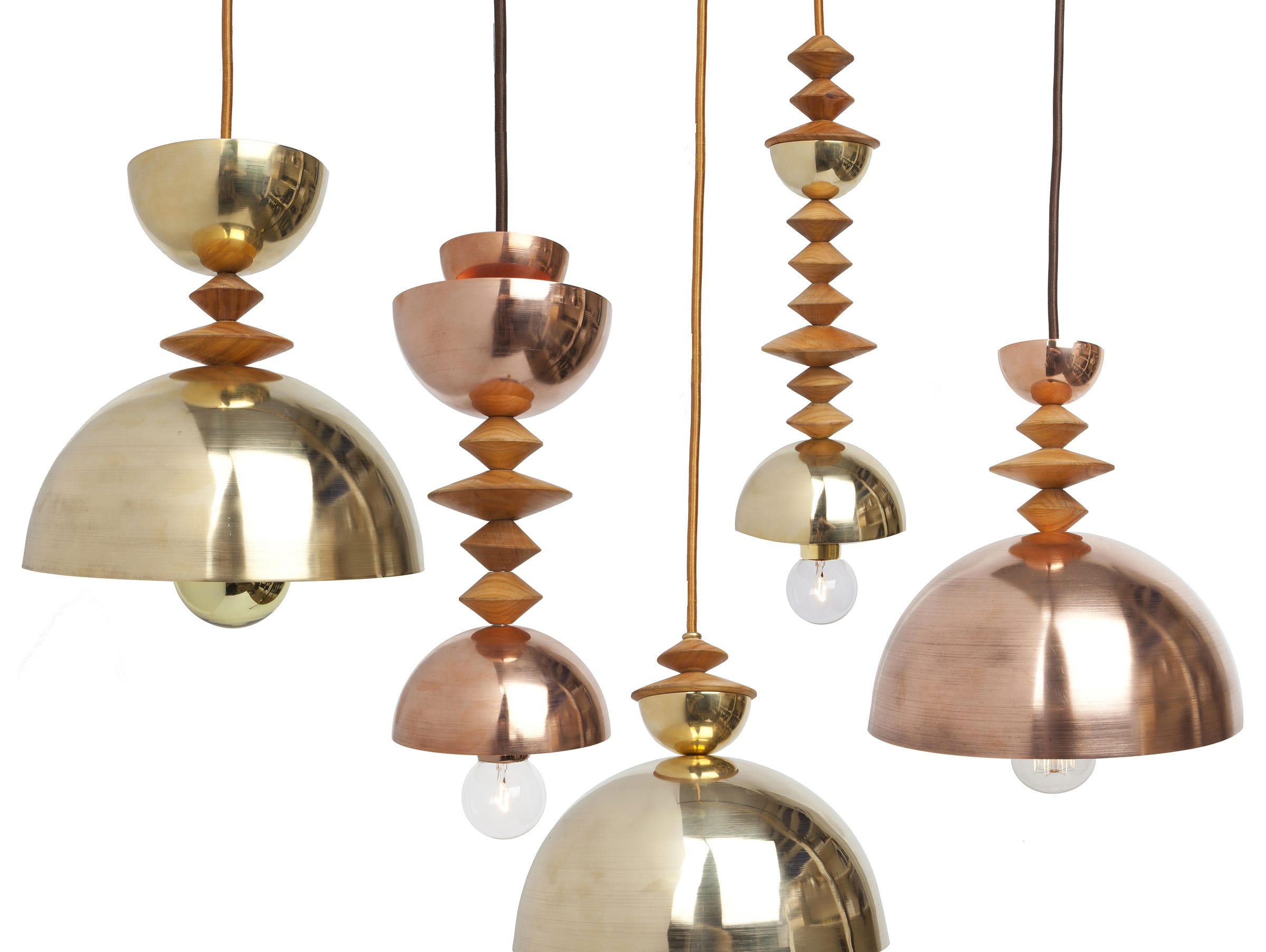 "New York designer Michele Varian is drawn to natural materials, so she says that unlike other lighting designers, all the metal components are solid (not plated or finished) brass, copper or steel. The sculptural Mala ""bead"" pendants were inspired by Romanian artist Constantin Brancusi and modern primitive design elements, created with simple geometric shapes and solid spun metal shades. The unfinished metal will gently patina with time."