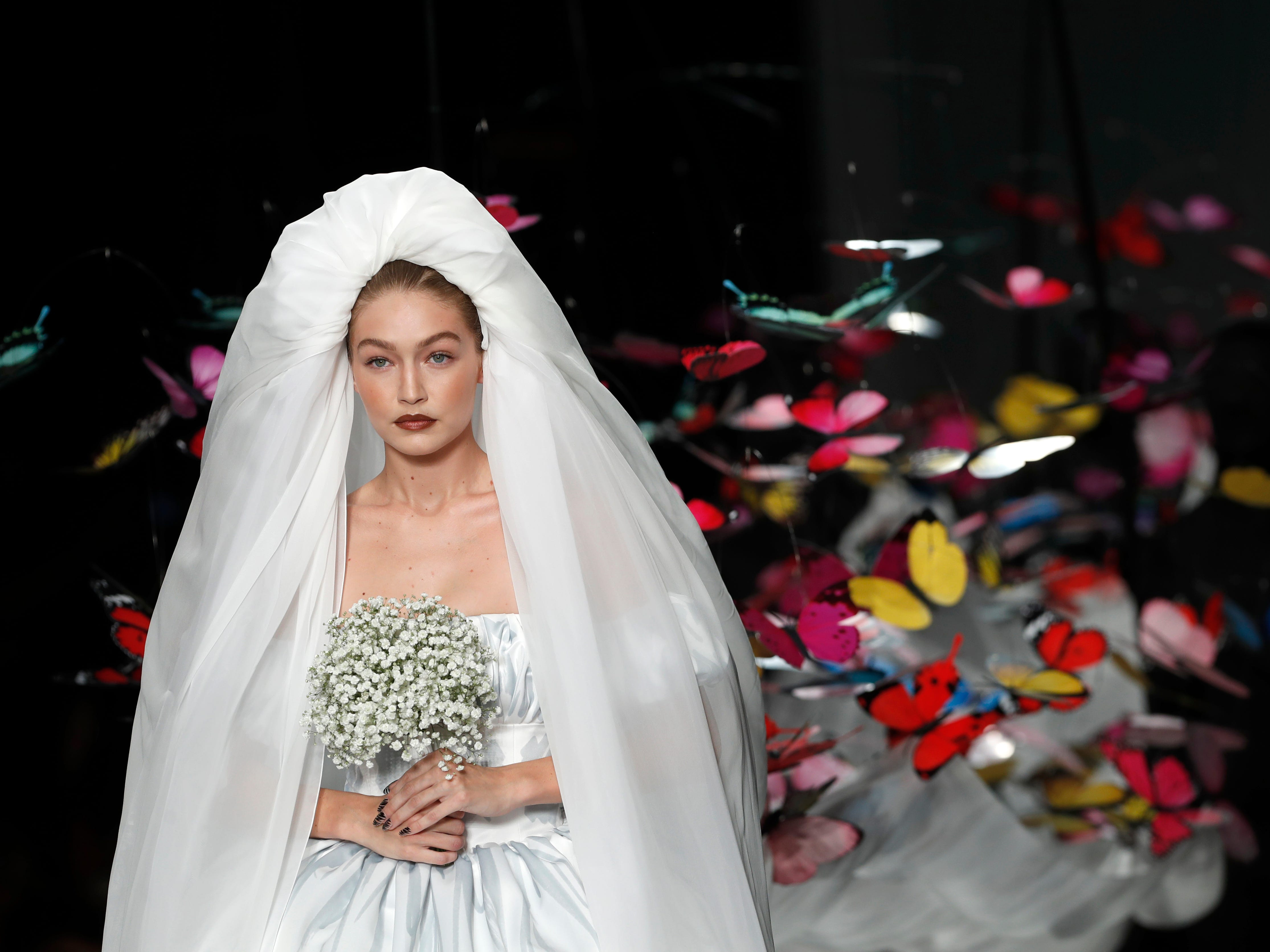Model Gigi Hadid wears a creation as part of the Moschino women's 2019 spring-summer collection, unveiled during Fashion Week in Milan, Italy, Thursday, Sept. 20, 2018.