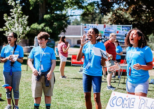 Corning-Painted Post High School freshman Merica Griffin, right, takes part in an anti-tobacco rally during this summer's Reality Check Youth Summit at Cazenovia College.