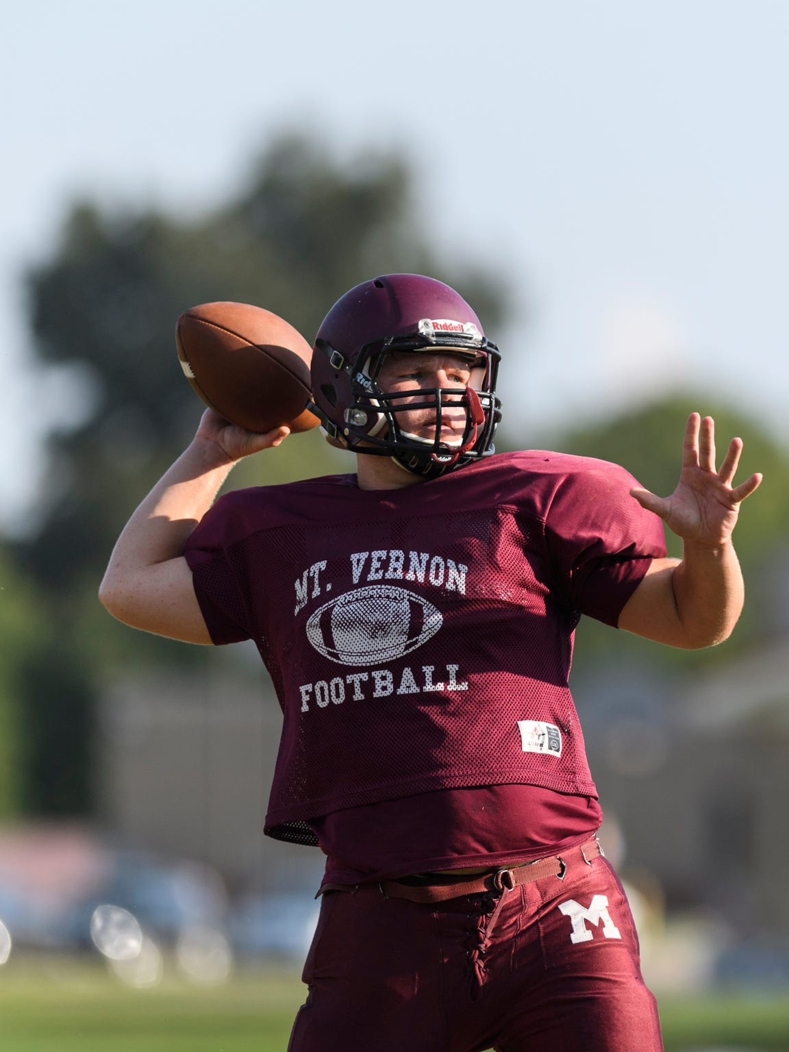 Mount Vernon Quarterback Rhett Snodgrass (7) runs passing drills with his teammates during an after school football practice at Mount Vernon High School in Mount Vernon, Ind., Tuesday, Sept. 18, 2018.