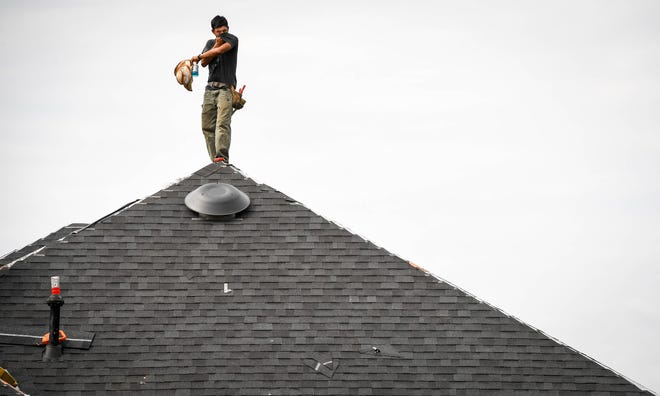 Braving this week's heat wave,  Aymer Montejo takes a break for a drink and to wipe the sweat off his face with his t-shirt while working for Schreiner Roofing replacing a roof on Merritt Drive in Henderson Wednesday, September 19, 2018.