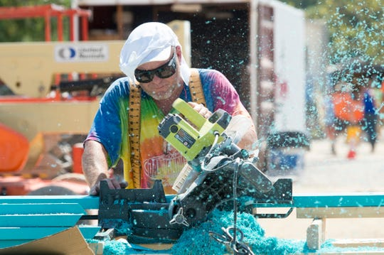 Chris Cason volunteers during the build of Mickey's Kingdom Park. Cason's employer gave him 9 days off so he can help with the construction. The new park is located along the riverfront in downtown Evansville.