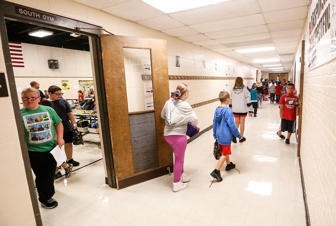 Students walk through the halls in between class periods Wednesday, Sept. 19, 2018 at Evans Elementary School in Fond du Lac, Wisconsin. The school district voted to place a $98.5 million referendum on the spring election ballot.