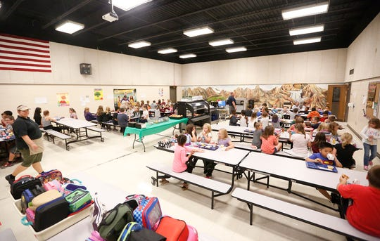 Students eat lunch Wednesday, Sept. 19, 2018 in Evans Elementary School in Fond du Lac, Wisconsin. Doug Raflik/USA TODAY NETWORK-Wisconsin