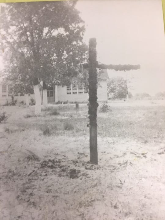 Willow Hill School was a target of violent racism. Here, a cross burns on its front yard in this 1940s photo.