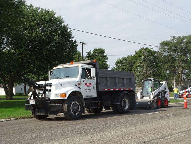 M-B Paving and Sealing of Columbus works on milled portion of East State Street in Fremont Thursday.