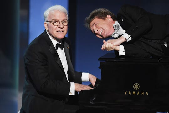 Steve Martin, left, and Martin Short perform during the American Film Institute's 45th Life Achievement Award Gala Tribute to Diane Keaton in 2017.