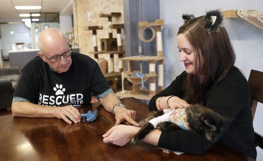 Elizabeth Feldhausen, founder of Safe Haven Pet Sanctuary Inc., sits with volunteer Terry Lauerman on Sept. 20, 2018 after announcing how many donations have been raised due to a photo of him napping with cats went viral online. Sarah Kloepping/USA TODAY NETWORK-Wisconsin