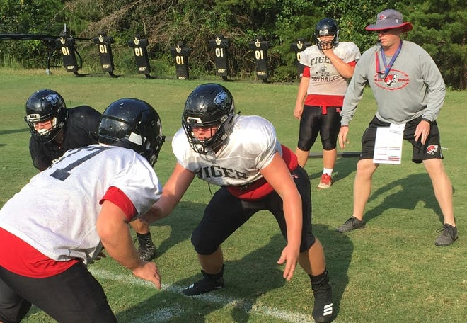 Blue Ridge football coach James Thurn oversees a drill during the Tigers' practice Wednesday in preparation for the team's game Friday in Vernon, Florida.