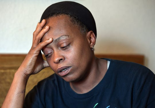 Mischell Jackson morns the death of her son Marquez Nash while sitting in her one-room apartment off Mauldin Road Thursday, September 20, 2018. Nash was found dead, along with his girlfriend Princess Fuller, in a Greer apartment Tuesday.