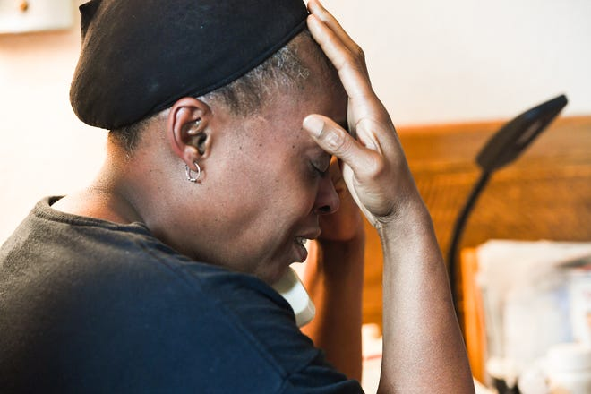 Mischell Jackson talks with a relative about the death of her son Marquez Nash while sitting in her one-room apartment off Mauldin Road Thursday, September 20, 2018. Nash was found dead, along with his girlfriend Princess Fuller, in a Greer apartment Tuesday.