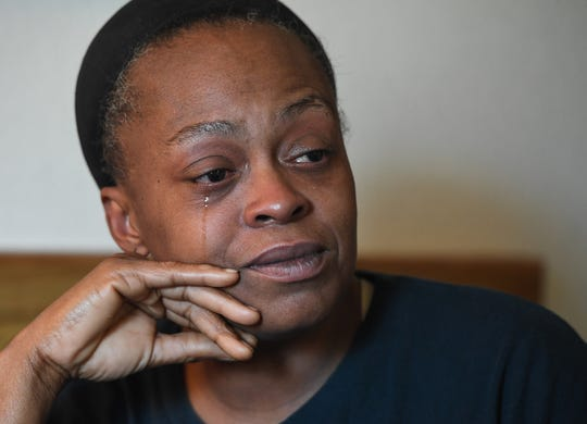 Mischell Jackson cries while talking about her son Marquez Nash while sitting in her one-room apartment off Mauldin Road Thursday, September 20, 2018. Nash was found dead, along with his girlfriend Princess Fuller, in a Greer apartment Tuesday.
