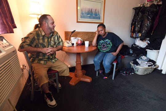 Mischell Jackson and her boyfriend Eric Smith sit in their one-room apartment off Mauldin Road Thursday, September 20, 2018. The pair are trying to get answers about the death of Jackson's son Marquez Nash, who was found dead, along with his girlfriend Princess Fuller, in a Greer apartment Tuesday.