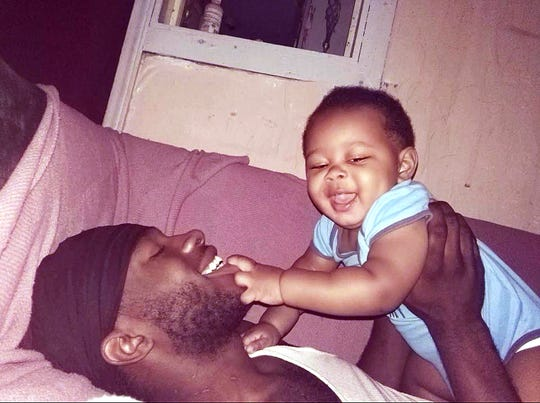 Marquez Nash holds his 1-year-old son, Josiah, in this photo provided by the family. Nash was found dead, along with his girlfriend Princell Icess Fuller, in a Greer apartment Tuesday.