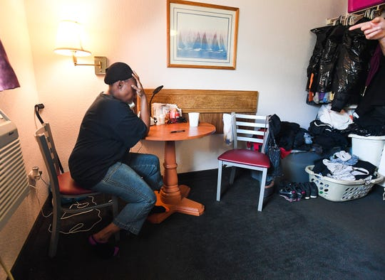 Mischell Jackson talks with a relative about the death of her son Marquez Nash while sitting in her one-room apartment off Mauldin Road Thursday, September 20, 2018. Nash was found dead, along with his girlfriend Princess Fuller, in a Greer apartment Tuesday,