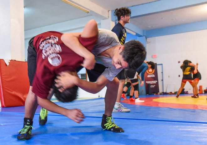 Simon Sanchez High School junior Gavin Whitt, in grey shirt, works to improve his take down technique as he trains with fellow wrestler, Jrake Rodriguez, at the team's training gym in Yigo on Tuesday, Sept. 18, 2018.