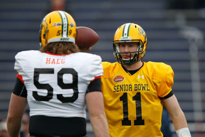 North Dakota State QB Carson Wentz #11 and teammate Joe Haeg #59 run through drills for the North team during NCAA college football practice for the Senior Bowl, Wednesday, Jan. 27, 2016, at Ladd–Peebles Stadium, in Mobil, Ala.