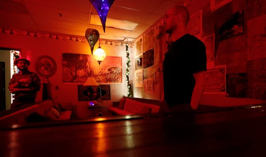 The bar is awash with red light at the Healer, an all-ages, interactive art and music venue, Thursday, Sept. 20, 2018.