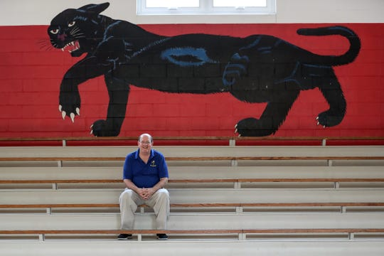 """Gus Adams, a town council member and Laurel High School alumnus, poses for a picture inside the school-turned community center in Laurel, Ind., Wednesday, Sept. 19, 2018. """"This is a home to people,"""" Adams said. """"When you walk in here it's like you have gone back home and I can't describe the feeling of how wonderful it is."""""""