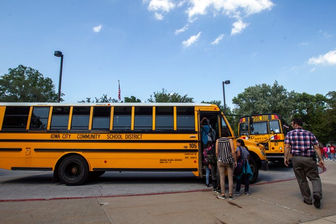 Iowa City Community School District school busses pick up students after dismissal on Thursday, Sept. 20, 2018, at Mark Twain Elementary in Iowa City.