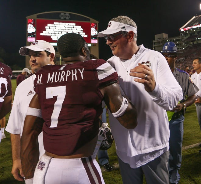 Mississippi State's Marcus Murphy (7) and Mississippi State head coach Joe Moorhead embrace following the win. Mississippi State played Stephen F. Austin in the 2018 football season opener at Davis-Wade Stadium in Starkville on September 1, 2018. Photo by Keith Warren/Mandatory Credit